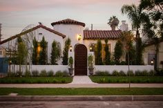 I love the low wall and door that frames the house. American Dream Builders Red Team Spanish House AFTER Mediterranean Architecture, Spanish Architecture, Architecture Design, Mediterranean Style Homes, Spanish Style Homes, Spanish House, Spanish Colonial, Spanish Revival Home, Spanish Modern