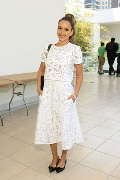 204b11963f47 Actress Jessica Alba wearing a white Tanya Taylor outfit and black Sarah  Flint shoes.