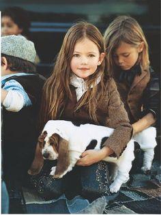 pretty little girl with basset hound puppy