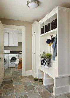 I am happy to have my mudroom/laundryarea. However if I could redo it this would be my inspiration.