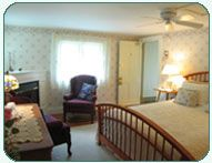 Corner room with custom designed and built queen bed, private shower bath,flat panel TV/DVD, gas fireplace with sitting area has beautiful views of Bartlett Mountain, Merriman State Forest, and perrenial gardens; also overlooks the backyard heated pool and hot tub area.