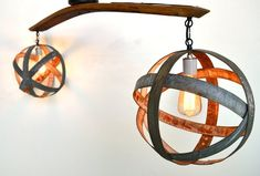 Wine Barrel Ring Atom Globe Hanging Chandelier- Double - RECYCLED from winecountrycraftsman on Etsy. Saved to Recycling is Cool. Wine Barrel Chandelier, Flush Mount Chandelier, Hanging Chandelier, Round Chandelier, Chandeliers, Wine Barrel Diy, Wine Barrel Rings, Wine Barrels, Wine Cellar