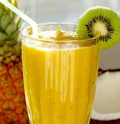 Tropical Five Fruit Blast Smoothie Recipe  1 large banana, peeled and cut into 1-inch pieces 2 kiwi fruit, peeled and quartered 1/2 cup peeled and diced mango 1/2 cup peeled and diced papaya 1 cup freshly squeezed orange juice 3 ice cubes
