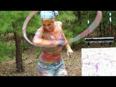 Drill some holes in your ugliest beater hoop. Pour in Tempura Paint. Set up some Canvases.  Katie Sunshine's Paint Hoop  Hooping.org