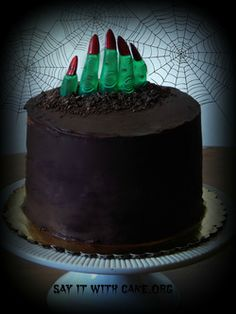 Here is a perfectly rich and delicious chocolate mousse cake turned into a gruesome Halloween cake! These zombie fingers coming out of the grave will be perfect for your Halloween party! Scary Halloween Cakes, Halloween Torte, Pasteles Halloween, Bolo Halloween, Halloween Sweets, Halloween Baking, Halloween Goodies, Halloween Food For Party, Halloween Birthday Cakes