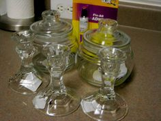 Dollar store DIYturn jars with lids and candlesticks from dollar store to faux apothocary jars