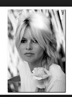 Long bangs on the side , sublime Brigitte Bardot .