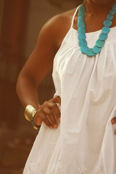 turquoise necklace white dress and gold cuff