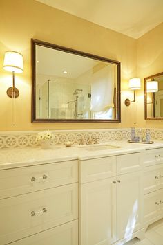 Girls bathroom renovation: Urban Electric Co. sconces, custom mirror, custom vanity, Thassos marble counter and floor, glass cabinet pulls; stone mosaic backsplash; daisy backsplash; daisy mosaic pattern, white lacquer vanity. For more inspo, check out http://www.susancorrydesign.com/portfolio/