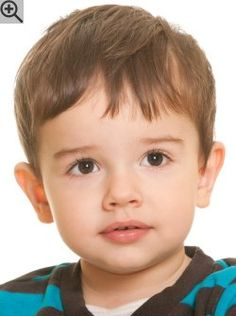 Short hairstyle for toddlers. A practical cut with very short sides and longer hair on the crown.