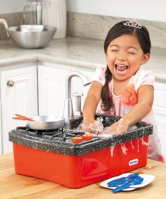 """Hands-on fun awaits with the Little Tikes Splish Splash Sink & Stove. Your little one will have a blast washing """"dirty"""" dishes after """"cooking"""" a yummy meal just like a grown-up. Clicking burner knobs and a working faucet make role-playing realistic. Water Tables, Pet Hair Removal, Little Tikes, Washing Dishes, Splish Splash, Science Experiments Kids, Winter Activities, Cooking, Coupon Lady"""