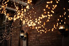 twinkly lights against exposed brick of loft-style apartment