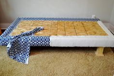 Upholstered bed frame by newlywoodwards, via Flickr