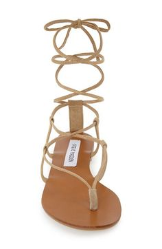 Free shipping and returns on Steve Madden 'Werkit' Gladiator Sandal (Women) at Nordstrom.com. Slender laces wind around your ankle and calf above a barely-there thong sandal that is perfect for warmer weather.