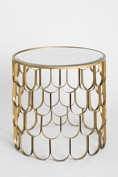 Plum & Bow Libby Side Table $149 at Urban Outfitters. |  SKU # 29069507 | Stunning metal side piece in a sweet scalloped design with a glass tabletop.