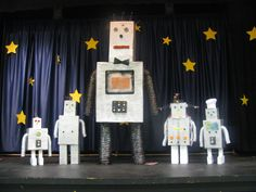 Robots created out of cardboard boxes and recycled items.  We made these for our Cub scout Blue and Gold banquet. The scouts loved them!