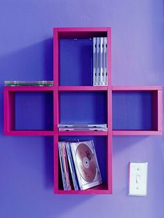 Try Decorative Storage - Here, a cross-shaped shelving unit provides perfect-size storage for CDs and it works double duty as decorative wall art.