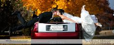 """Bride and groom kissing """"over"""" a red Cadillac convertible. Image taken in the Fall colors at Long Lake Regional Park in New Brighton, Minnesota. Images and videos ©2012 Michael and Joannie Anderson of Michael Anderson Photography. Minnesota's Husband and Wife Wedding Photography Team since 1986."""