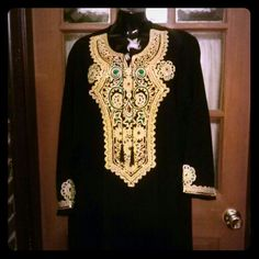 "NWOT Black Abaya Caftan Jilbab Dress This is absolutely gorgeous! Unfortunately, the pics don't do it justice. This long black dress is embellished with embroidery of metallic golds, blues and rust on the yoke and cuffs. There are (2) 13"" tassels attached to the top of the yoke. The back is plain. The size tag says XL. Measurements: 23"" armpit to armpit, length is 54"", sleeves 22"". The price is firm as it is already deeply discounted! Dresses"