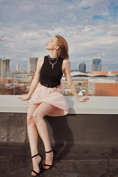 fromamber.com — marilyn monroe inspired rooftop photoshoot — black cropped sweater, blush tiered skirt, black strappy heels, costume jewelry — old hollywood inspired holiday style