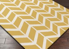Surya Fallon FAL-1092 Area Rug From delicate lattice patterns to boldly colored chevron patterns the Fallon Collection makes a statement in flat weave; from creator Jill Rosenwald known for her beautifully colored, hand-made ceramics.