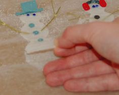 Snowman Glue Craft - They can be attached to a ribbon, as shown below, to become a cute snowman garland. Or, individual snowmen can be turned into magnets, pins, or used to adorn gift packages and bags. These come out really cute and are fun to make!