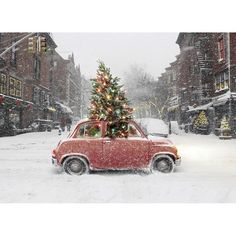 packed- little red car with lighted Christmas tree through sunroof on snowy day  www.mulberryinteriors.ca