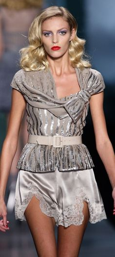 Christian Dior - like the top but not sure I would wear the bottoms outside of the bedroom.