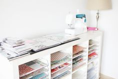 """Kallax Hack: """"The second shelf unit is full of those Display Dynamics 12x12 trays and all my pattern paper and page protectors. Right now the pattern paper is organized by manufacturer and the page protectors are separated by style."""""""