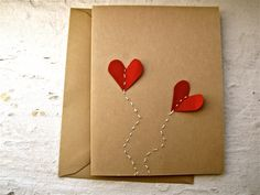 hand-stitched card featuring two heart balloons