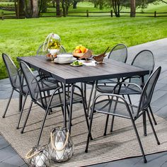 The Carmack 7-Piece Dining Set from Threshold is great for any outdoor space.  Enjoy a morning coffee or the evening sunset with this stylish chair set.  All pieces are made with durable, rust-resistant steel frame, and are finished in classic black.   The 6 chairs are made with a steel mesh surface for comfortable reclining and the table has a metal top with a faux wood finish. The chairs are easily stackable for convenient storage.