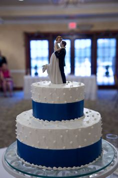 Our chocolate wedding cake. Blue ribbon around, with edible pearls, and David's Bridal cake topper