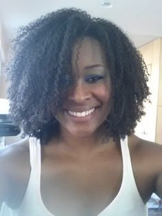 Complete Wash and Go Demo on Natural Hair. She's also a stylist and has great tips to share. #TeamWashAndGoHair http://www.shorthaircutsforblackwomen.com/curl-defining-products/