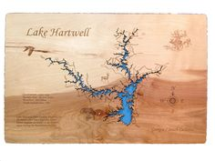 Lake Hartwell, Georgia: Standout Wood Map Wall Hanging. This is a beautifully detailed, laser engraved and precision cut topographical Map of Lake Hartwell, bordering Georgia and South Carolina with the following interesting stats carved into it: Lake Hartwell, Hart County, Hartwell GA All named after Nancy Hart due to her heroic exploits on behalf of the Patriots cause during the revolutionary war. Constructed: 1955 - 1959. Surface area: 56,000 acres Shoreline: 962 miles Depth behind…