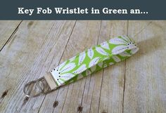 """Key Fob Wristlet in Green and White Floral Designer Fabric. This Key Fob Wristlet is a must have. They key fob wristlet allows you to have your hands free but still have your keys close at hand. Perfect for when you are carrying all those groceries in the house from the car (and lets face it, we all play that """"I'm only making one trip"""" game) and your keys are right there on your wrist. No need to have to dig in your bag for your keys, they are right there easily accessible. Not only that…"""