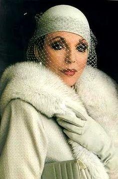 "Costume designer Nolan Miller (Chouinard) dressing Joan Collins in ""Dynasty"""