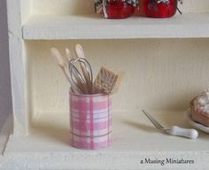 Kitchen Utensils in Pink Plaid Canister - could do this myself with any mini print paper - this is just paper, sealed inside and out with gloss acrylic to give it body