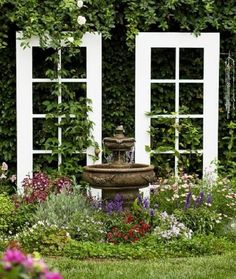 Use old French doors as a trellis for vines in the garden