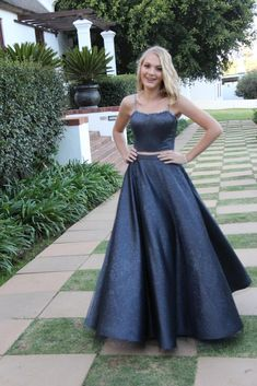 Charcoal two piece eveningwear with a glitter tulle overlay to capture great movement.