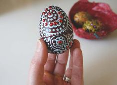 plastic easter egg painted with puff paint.  Make these for girlfriends!