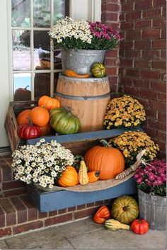 business in the front party in the back fall porch decor for all, porches, seasonal holiday decor, Pumpkins and mums inside an old blue trunk and on top of a whiskey barrel Autumn Decorating, Pumpkin Decorating, Porch Decorating, Decorating Ideas, Decor Ideas, Diy Ideas, Creative Ideas, Pumpkin Colors, Pumpkin Ideas