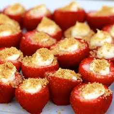 Cheesecake Stuffed Strawberries - What a cute and novel idea for how to serve strawberry cheesecake! And small bite sized portions too!