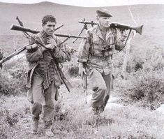 In Algeria, a french paratrooper of Foreign Legion (1er REP) with a captured fellagha. Weapons come from the rebel unit which has been destroyed.