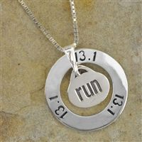 Our beautiful sterling silver half marathon sport ring pendant features a sterling silver ring embossed with the 13.1 phrase and our sterling silver run charm hanging from the ring. Makes a special memento of a great accomplishment!