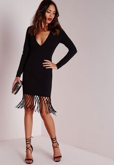 Cause a little chaos this season in this seriously chic black bodycon dress. With fierce long sleeves, plunging neckline and on point fringed hem this figure flattering dress will give you that killer silhouette. Team with lace up heels and...