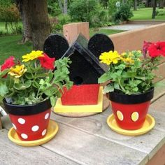 Plant a Disney garden by painting pots and a bird feeder with yellow, white, black, and red paint. Just glue some little ears to the top of the bird house. Cute!