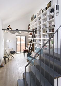 Inspiring dwelling in Madrid displaying a cool home library