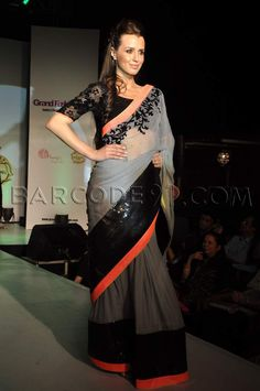 Grey and Black! Love this design except that the sequins does obstruct the flow of the saree, a bit. But, we can manage that, can't we?