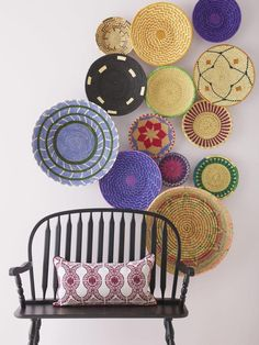 What a fun way to decorate! Try hanging woven baskets of different sizes and colors.
