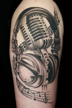 microphone tattoo -- hope they took this in a mirror since the G-clef and notes are backwards!